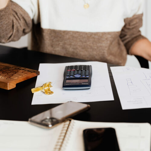 crop-woman-using-calculator-while-counting-bills-in-4491441